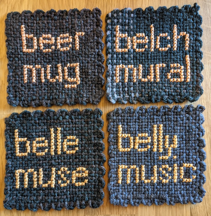 four gray coasters, sewn with the following phrases: beer mug, belch mural, belle muse, belly music